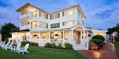Inn at Harbor Hill Summer Patio View 500x250 - Distinctive Inns of New England