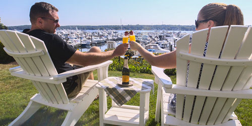 Toasting Guests 500x250 - Inn at Harbor Hill Marina B&B - Niantic, CT