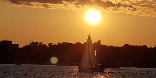 Sunset & Sailboat 500x250 - Black Hawk Party Boat - Niantic, CT